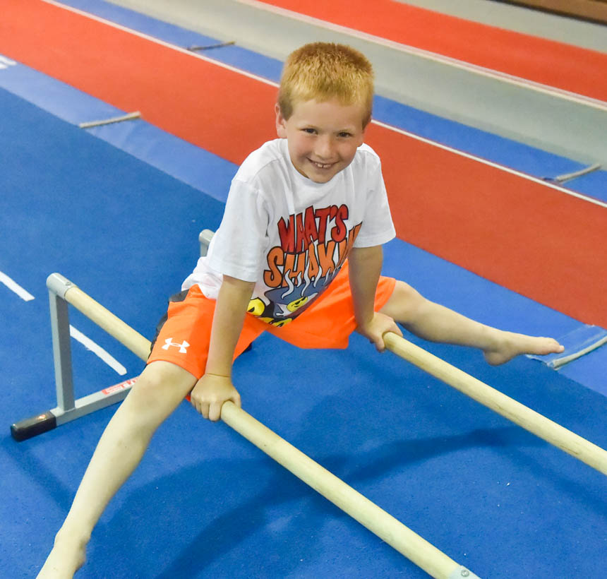 Boy straddling two bars