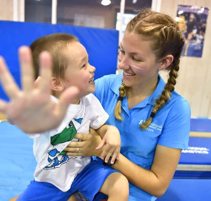 Toddler with a coach in class